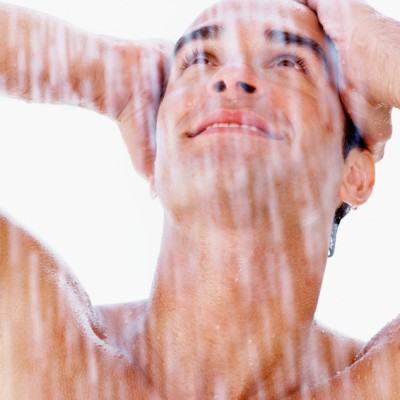 Young man enjoying a shower